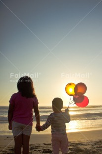 Fair Trade Photo Activity, Balloon, Beach, Brother, Colour image, Colourful, Evening, Family, Friend, Friendship, Hand, Holding, Holding hands, Light, Looking, Looking away, People, Peru, Sea, Shooting style, Silhouette, Sister, Sky, South America, Standing, Sun, Sunset, Two, Two people, Two persons, Vertical