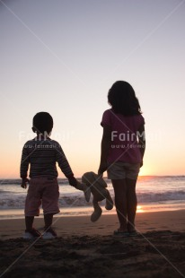 Fair Trade Photo Activity, Animals, Beach, Brother, Colour image, Colourful, Evening, Family, Friend, Friendship, Hand, Holding, Holding hands, Light, Looking, Looking away, People, Peru, Puppy, Sea, Shooting style, Silhouette, Sister, Sky, South America, Standing, Sun, Sunset, Two, Two people, Two persons, Vertical