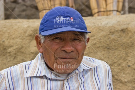 Fair Trade Photo Activity, Beach, Cap, Casual clothing, Clothing, Colour image, Day, Horizontal, Latin, Looking at camera, One man, Outdoor, People, Peru, Portrait headshot, Smiling, South America