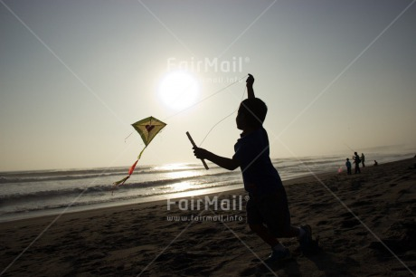 Fair Trade Photo Activity, Backlit, Beach, Colour image, Evening, Freedom, Heart, Kite, Love, One boy, Outdoor, People, Peru, Playing, Sea, Silhouette, Sky, South America, Summer, Sunset, Water