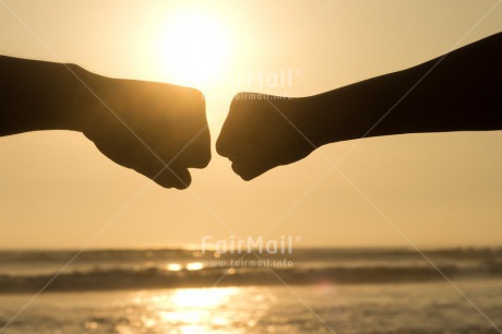 Fair Trade Photo Beach, Brother, Colour image, Evening, Fist, Friendship, Horizontal, Ocean, Outdoor, People, Peru, Sea, Shooting style, Silhouette, South America, Success, Sunset, Team, Together