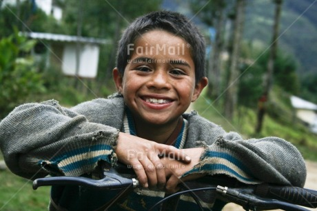 Fair Trade Photo 5 -10 years, Activity, Bicycle, Colour image, Horizontal, Latin, Looking at camera, One boy, People, Peru, Portrait halfbody, Rural, Smile, Smiling, South America, Transport