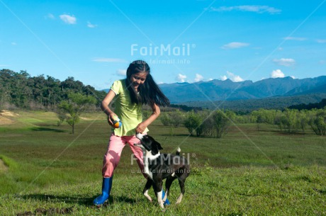 Fair Trade Photo Activity, Animals, Ball, Colour image, Day, Dog, Emotions, Friendship, Happiness, Horizontal, Jumping, Mountain, One girl, Outdoor, People, Peru, Playing, Rural, Smiling, South America, Together