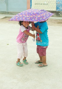 Fair Trade Photo Activity, Colour image, Day, Emotions, Friendship, Happiness, Outdoor, People, Peru, Playing, Smiling, South America, Together, Two children, Vertical