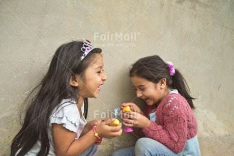 Fair Trade Photo Activity, Colour image, Emotions, Friendship, Happiness, Horizontal, People, Peru, Playing, Smiling, Soapbubble, South America, Two girls, Water