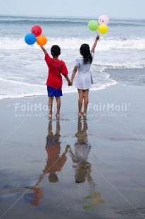 Fair Trade Photo Activity, Beach, Colour image, Cooperation, Emotions, Friendship, Happiness, Love, People, Peru, Playing, Sea, South America, Summer, Together, Two children, Vertical