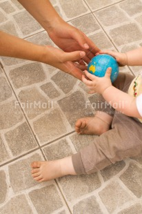 Fair Trade Photo 0-5_years, Activity, Baby, Caucasian, Colour image, Gift, Globe, Hands, Holding, Holiday, People, Peru, Sitting, South America, Travel, Travelling, Vertical, World