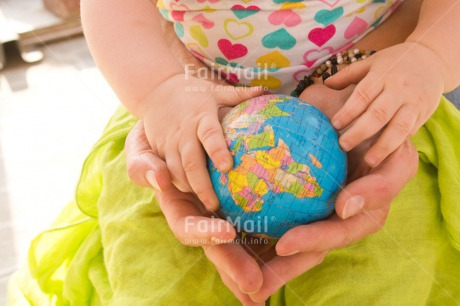Fair Trade Photo 0-5_years, Activity, Baby, Caucasian, Colour image, Gift, Globe, Hands, Holding, Holiday, Horizontal, Mother, People, Peru, Sitting, South America, Travel, Travelling, World