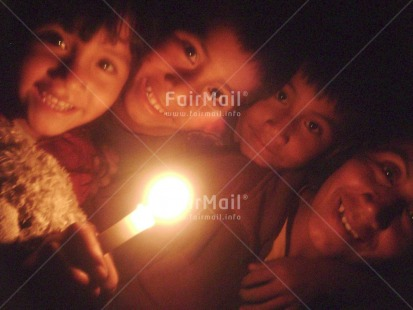 Fair Trade Photo 5-10_years, Activity, Candle, Christmas, Colour image, Family, Flame, Good luck, Group of children, Horizontal, Indoor, Looking at camera, Night, People, Peru, South America, Strength, Thinking of you, Together