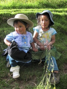 Fair Trade Photo Activity, Blue, Colour image, Cute, Dailylife, Friendship, Green, Looking at camera, Multi-coloured, Nature, Outdoor, People, Peru, Portrait fullbody, Sitting, South America, Together, Two children, Two girls, Vertical
