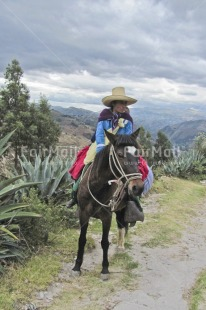 Fair Trade Photo Andes, Animals, Colour image, Condolence, Dailylife, Ethnic-folklore, Horse, Mountain, Multi-coloured, Nature, One woman, Outdoor, People, Peru, Portrait fullbody, Rural, Scenic, Sombrero, South America, Vertical