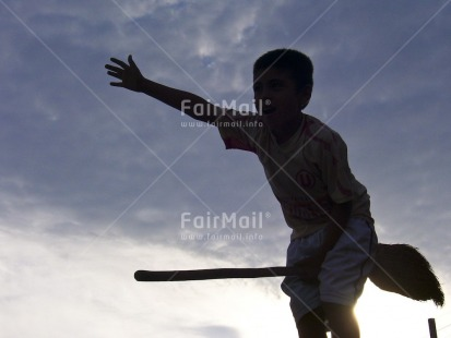 Fair Trade Photo 10-15 years, Activity, Backlit, Colour image, Day, Flying, Funny, Horizontal, One boy, Outdoor, People, Peru, Silhouette, Sky, South America