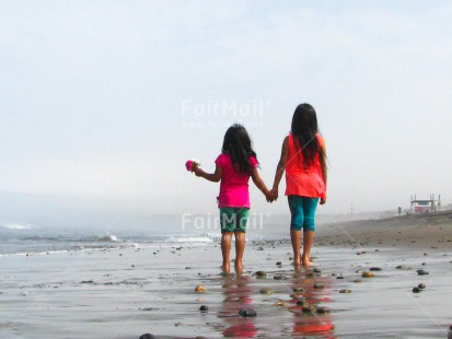 Fair Trade Photo 10-15_years, 5_-10_years, Activity, Beach, Children, Colour image, Flowers, Friendship, Girls, Holding, Holding hands, Horizontal, Latin, People, Peru, Sea, Sister, Sorry, South America, Thank you, Walking, Water
