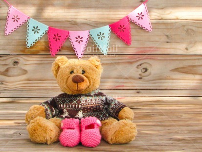 Fair Trade Photo Activity, Animals, Bear, Birth, Colour image, Horizontal, New baby, Peru, Pink, Pullover, Shoe, Sitting, South America, Wood