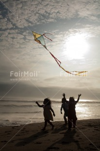 Fair Trade Photo 5_-10_years, Activity, Beach, Colour image, Emotions, Evening, Freedom, Group of girls, Happiness, Kite, Outdoor, People, Peru, Playing, Sea, Sky, South America, Summer, Sun