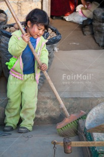 Fair Trade Photo 5 -10 years, Activity, Casual clothing, Child labour, Cleaning, Clothing, Colour image, Dailylife, Day, Latin, Market, One girl, Outdoor, People, Peru, Rural, South America, Sweeping, Vertical