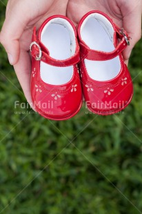 Fair Trade Photo Birth, Colour image, Girl, New baby, People, Peru, Shoe, South America, Vertical