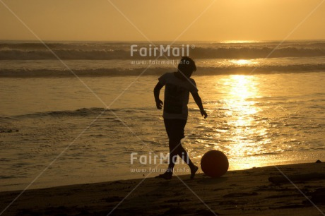Fair Trade Photo Activity, Ball, Beach, Boy, Child, Colour image, Evening, Horizontal, Ocean, Outdoor, People, Peru, Playing, Sea, Soccer, South America, Sunset