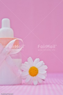 Fair Trade Photo Biberon, Birth, Colour image, Daisy, Flower, Girl, New baby, People, Peru, Pink, South America, Vertical