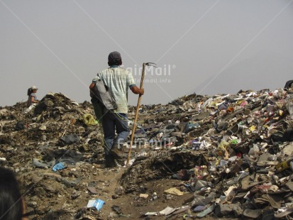 Fair Trade Photo Activity, Casual clothing, Clothing, Colour image, Day, Garbage, Garbage belt, Horizontal, Looking away, One man, One woman, Outdoor, People, Peru, Portrait fullbody, South America, Walking