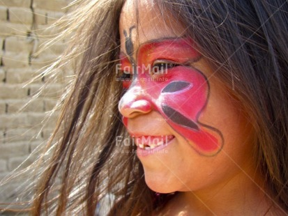 Fair Trade Photo 5-10_years, Activity, Butterfly, Colour image, Day, Decoration, Ethnic-folklore, Horizontal, Looking away, One child, One girl, Outdoor, People, Peru, Portrait headshot, Smiling, South America