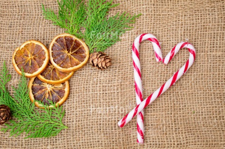 Fair Trade Photo Adjective, Candy stick, Christmas, Christmas decoration, Colour, Colour image, Food and alimentation, Fruits, Horizontal, Object, Orange, Pine, Pine cone, Place, Red, South America, White