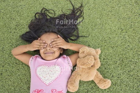 Fair Trade Photo Activity, Animals, Bear, Child, Colour image, Emotions, Felicidad sencilla, Girl, Hand, Happiness, Happy, Horizontal, New beginning, People, Peru, Play, Playground, Playing, Smiling, South America, Teddybear