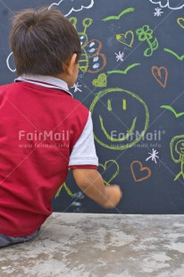 Fair Trade Photo Activity, Blackboard, Boy, Chalk, Child, Colour image, Draw, Drawing, Emotions, Felicidad sencilla, Happiness, Happy, People, Peru, Play, Playing, South America, Vertical