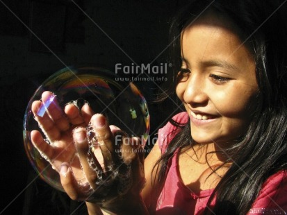 Fair Trade Photo 5-10_years, Artistique, Black, Care, Colour image, Day, Earth, Hope, Horizontal, One girl, Outdoor, People, Peru, Pink, Portrait headshot, Responsibility, Soapbubble, South America, Transparent, Values