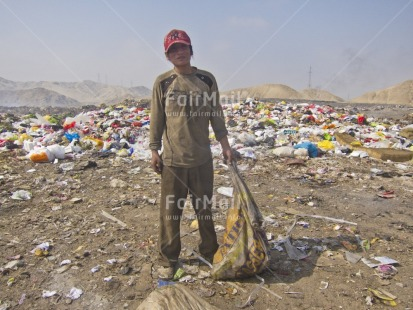 Fair Trade Photo 20-25_years, Activity, Casual clothing, Child labour, Clothing, Colour image, Day, Garbage, Health, Hygiene, Looking at camera, One boy, Outdoor, People, Peru, Portrait fullbody, Recycle, Safety, Sanitation, South America, Standing, Vertical, Working
