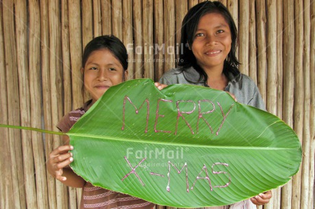 Fair Trade Photo Activity, Christmas, Colour image, Day, Green, Latin, Leaf, Letter, Looking at camera, Outdoor, People, Peru, Portrait halfbody, Smiling, South America, Two girls