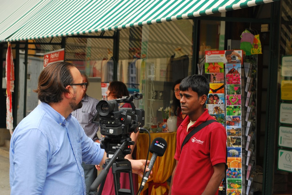 Dhiraj giving a television interview in Wurzburg