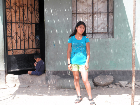 Patricia in front of her mother's house.