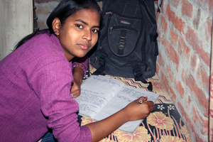 Sandhya doing her homework at home