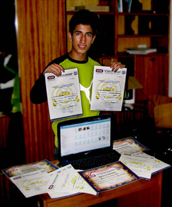 Elmer with his laptop and graphic design certificates