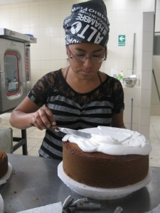 Patricia finishing off a birthday cake