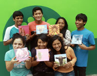 FairMail Peru teenagers showing their own fairtrade photography books