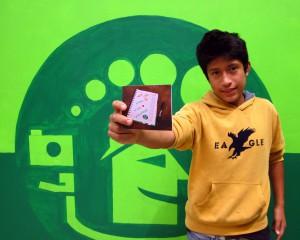 FairMail Peru photographer Sebastian showing his Ben & Jerry Christmas card