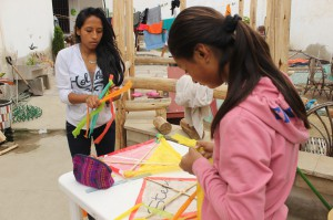 Anidela and Ruth making kites from trash