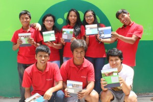FairMail teenagers presenting DHV-GL's tailor made corporate calendar
