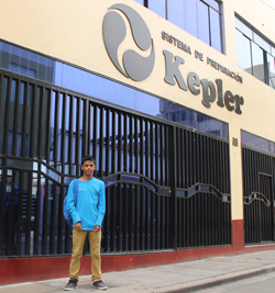 FairMail Peru photographer Juan Gabriel standing in front of the Kepler Academy