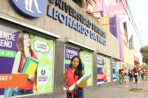 Anidela in front of the university where she is studying